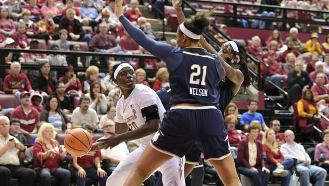 FSU senior forward Shakayla Thomas (20) trying to find one of her teammates during the third quarter of FSU's game versus Notre Dame.