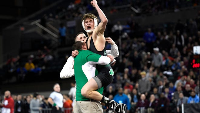 Camden Catholic Lucas Revano celebrates his win in the 132-pound semifinal bout during the NJSIAA wrestling championships in Atlantic City, NJ on Saturday, March 3, 2018. Revano won by decision, 3-2.