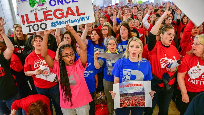 Teachers hold a rally outside the Senate Chambers in the West Virginia Capitol on Monday.