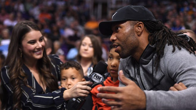 Mar 28, 2018: Cardinals wide receiver Larry Fitzgerald is interviewed during the first half of the game between the Phoenix Suns and the LA Clippers at Talking Stick Resort Arena.