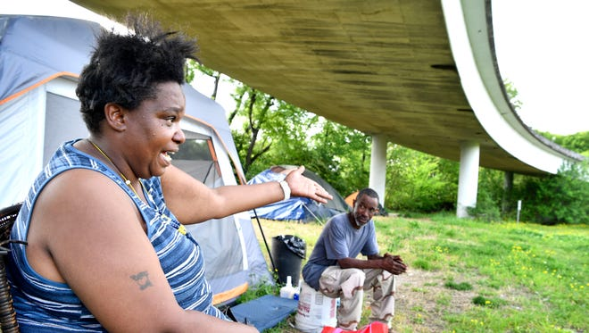 """Angela Brown has lived under an overpass in East Nashville for 3 years and really doesn't want to leave. """"I don't have anywhere else to go"""" she said. Metro is planning to close one of Nashville's largest homeless camps, called Ellington Camp, in East Nashville.  Wednesday May 2, 2018, in Nashville, Tenn."""