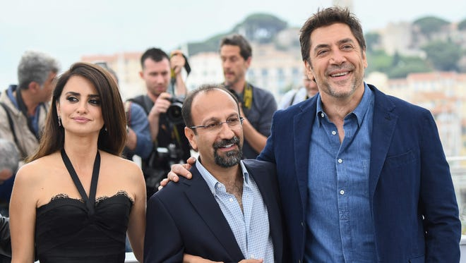"""Penelope Cruz, director Asghar Farhadi and Javier Bardem at a Cannes photocall Wednesday for their film, """"Everybody Knows."""""""