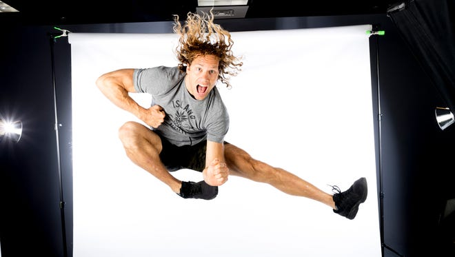 American Ninja Warrior contestant and Knoxville native Grant McCartney does a ninja kick in the Knoxville News Sentinel photo studio in Knoxville, Tennessee on Friday, June 1, 2018.