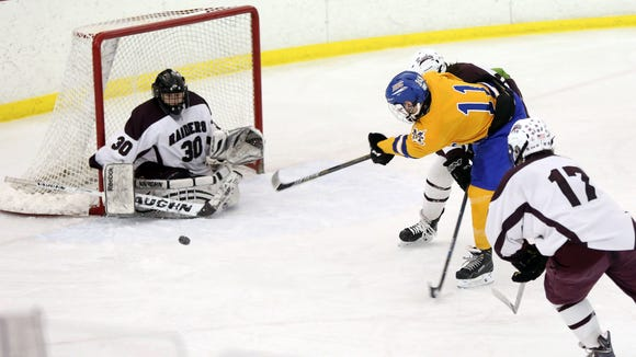 Scarsdale goaltender Sam Seltzer stops a Mahopac shot during a Section 1 Division 1 quarterfinal at the Ice Hutch in Mount Vernon Wednesday. Scarsdale defeated Mahopac 3-0.
