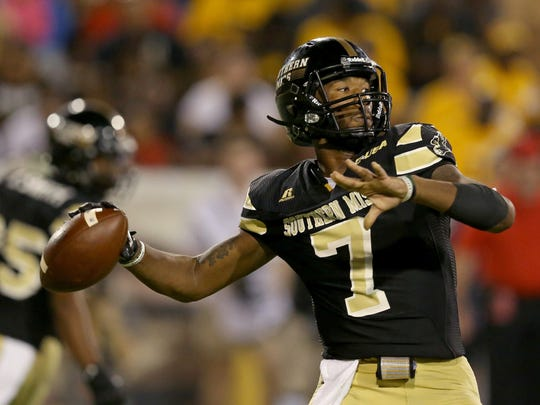 Southern Miss quarterback Kwadra Griggs (7) makes a throw in the second half Saturday against North Texas at M. M. Roberts Stadium. North Texas won 43-28.