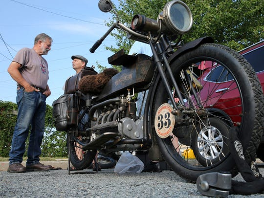 Enthusiasts talk near a vintage motorcycle Thursday in Atlantic City as they prepare for the Motorcycle Cannonball.