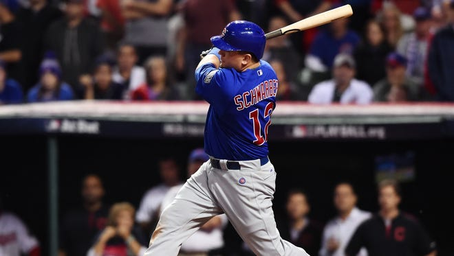 Chicago Cubs player Kyle Schwarber hits a single against the Cleveland Indians in the 10th inning of game seven of the 2016 World Series on Wednesday night.