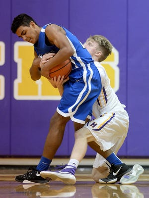 Hagerstown's Isaiah Neal and Centerville's Justin Dupree grapple for the ball during the Class 2A basketball sectional semi-finals Friday, March 4, 2016  in Hagerstown.