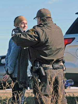 A Morton County Sheriff's deputy officer arrests actress Shailene Woodley at a protest against the Dakota Access Pipeline near St. Anthony, N.D., Monday, Oct. 10, 2016. The U.S. Army Corps of Engineers won't yet authorize construction of the $3.8 billion, four-state Dakota Access oil pipeline on federal land in southern North Dakota, it said Monday, along with reiterating its earlier request that the pipeline company voluntarily stop work on private land in the area.