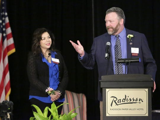 Drew and Diane MacDonald receive the Janet Berry Volunteer of the Year Award during the Celebrating Our Volunteers gala Tuesday at the Radisson Paper Valley Hotel in Appleton.
