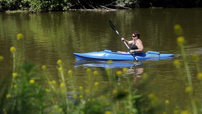 Jan Lamis, of Colman, kayaks along the Big Sioux River near Pasley Park in Sioux Falls on July 19.