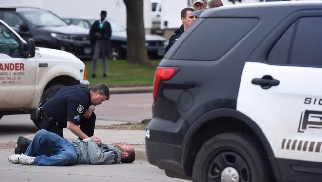 Police respond to a pedestrian hit by a car at 10th Street and Spring Ave Wednesday, April 6, 2016.