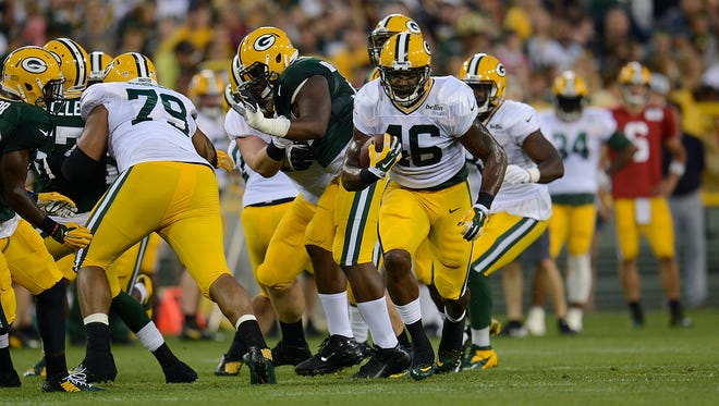 Green Bay Packers running back Alonzo Harris (46) runs with the ball during Packers Family Night at Lambeau Field on Saturday, Aug. 8, 2015.