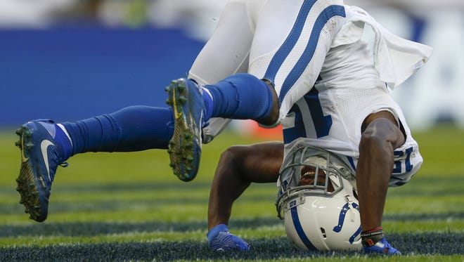 Indianapolis Colts wide receiver Phillip Dorsett (15) is knocked to the ground after celebrating with wide receiver Chester Rogers (80) after pulling in a long touchdown pass by quarterback Andrew Luck (12) against the Jacksonville Jaguars during a NFL International Series game at Wembley Stadium in London on Oct. 2, 2016.