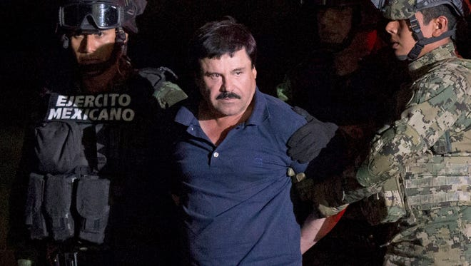 "Mexican drug lord Joaquin ""El Chapo"" Guzman is escorted by army soldiers on Jan. 8, 2016, to a waiting helicopter at a federal hangar in Mexico City, after he was recaptured following his escape from a maximum security prison in Mexico."