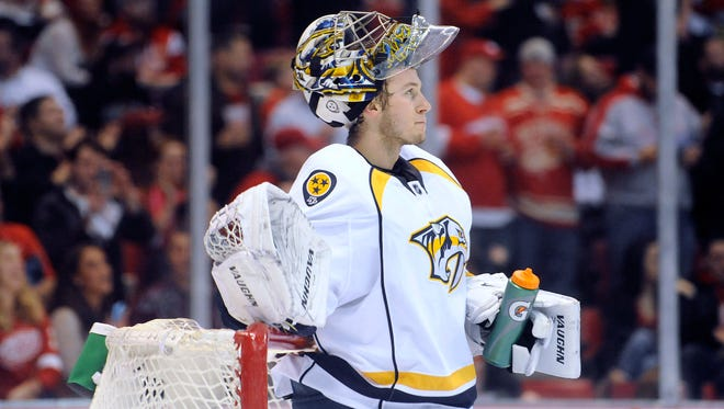 Predators goalie Marek Mazanec looks at the scoreboard after allowing a goal by Tomas Tatar in the second period Saturday.