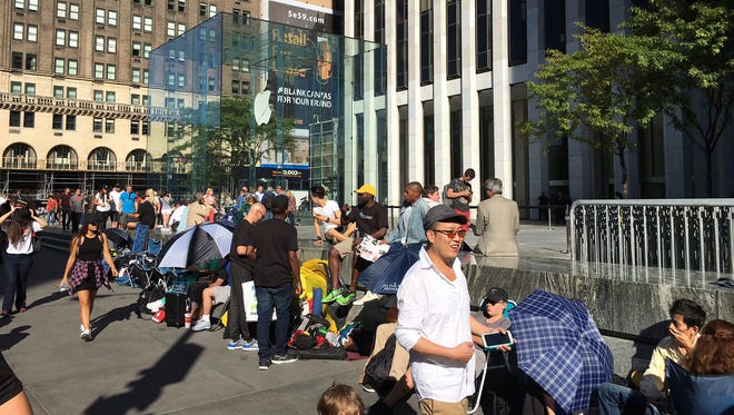 People wait in line at the Apple store in New York for a the new iPhone 7.