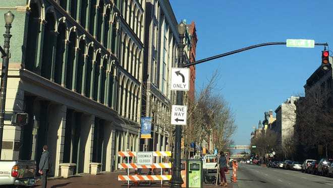 A parking lane and four feet of sidewalk are closed indefinitely along three blocks of Main Street in downtown Louisville for sewer line repairs