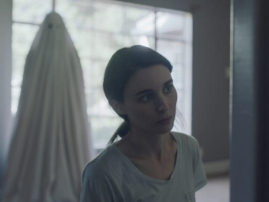 Casey Affleck stars as a bedsheet-clad phantom who