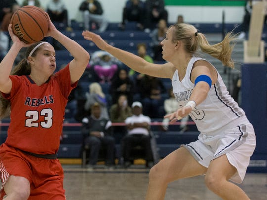 Saddle River Day's Michelle Sidor (23) tries to pass the ball by Manasquan's Dara Mabrey. Manasquan Girls Basketball vs Saddle River Day in NJSIAA Tournament of Champions semifinal game at Toms River on March 16, 2018.