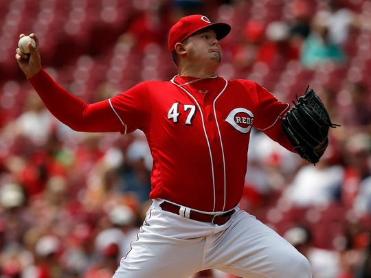 Cincinnati Reds starting pitcher Sal Romano (47) delivers a pitch in the top of the first inning of the MLB National League game between the Cincinnati Reds and the New York Mets at Great American Ball Park in downtown Cincinnati on Wednesday, May 9, 2018.