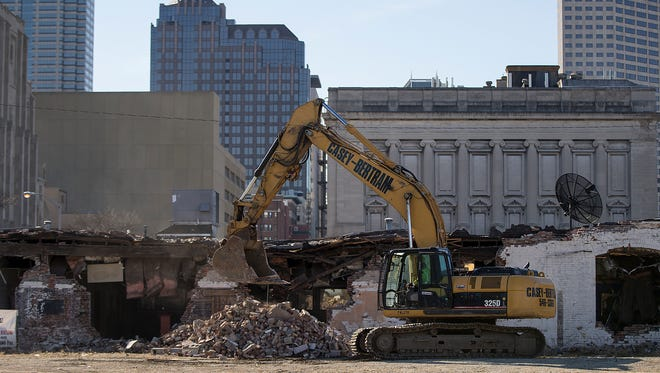 Crews demolish the building at 705 N. Illinois St., making way for the Phoenix Theatre's future home to be built , Wednesday, Feb. 15, 2017.