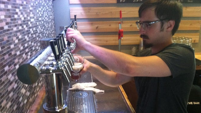 Proof Brewing Co., opened the doors to a good-size production brewery in Railroad Square that also features a tasting room and beer garden.