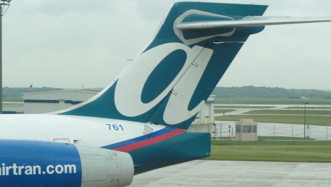 The tail of an AirTran Airways Boeing 717 at the Gerald R. Ford International Airport near Grand Rapids, Mich., on Sept. 29, 2011.