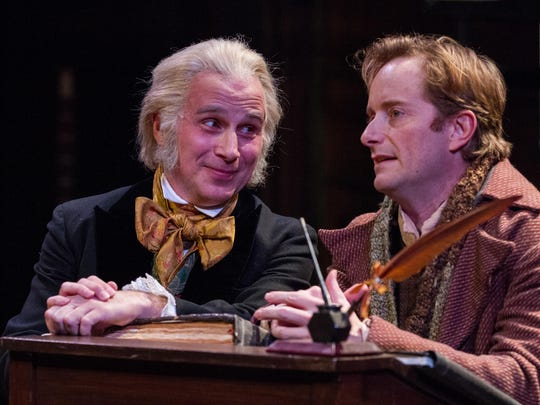 """John Plumpis as Scrooge and Jeffrey C. Hawkins as Bob Cratchit in Delaware Theatre Company's """"A Christmas Carol."""""""