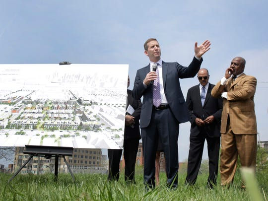 Steve Rosenthal, a principal of Bedrock Development, talks to members of the media and neighbors at the news conference to announce the development partnership that will transform about 8 acres in Brush Park, Wednesday, May 6, 2015, in Detroit. About 300 new residential units are planned as part of the $70 million development in the neighborhood just north of downtown Detroit.