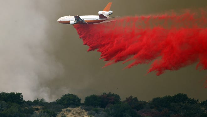 A DC-10 makes a drop on the east flank of the Sherpa Fire in Santa Barbara County, Calif., Friday, June 17, 2016. The fire prompted evacuations but firefighters say they're hoping gain more control Saturday.