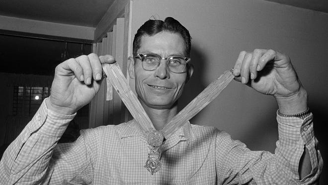 Desmond T. Doss, a Seventh-day Adventist and the only conscientious objector to win the Medal of Honor, displays his medal at his home in Rising Fawn, Ga., April 5, 1966. Doss won the medal as a medic on Okinawa in 1945. He says he would serve again if called upon.