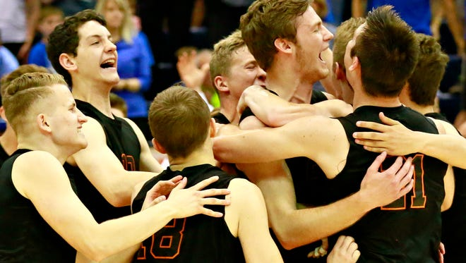 Northeastern celebrates a 3-1 win over Beaver County Christian during PIAA boys' state volleyball championship action at Rec Hall in State College, Saturday, June 10, 2017. Dawn J. Sagert photo