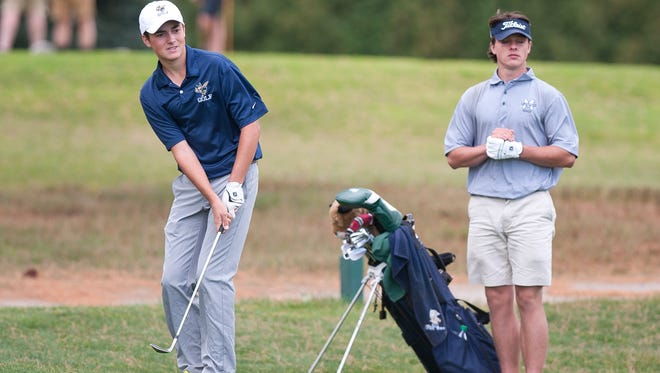Essex's Ben LaPlant, left, chips toward the hole on the sixth green during the NVAC boys golf championships on Thursday at Williston.