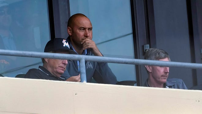 Miami Marlins CEO and former Yankee Derek Jeter watches the game against the St. Louis Cardinals on March 10, 2018.