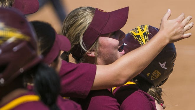 Arizona State players celebrate their win on an error  in their final at-bat on April 19 at Farrington Stadium in Tempe.