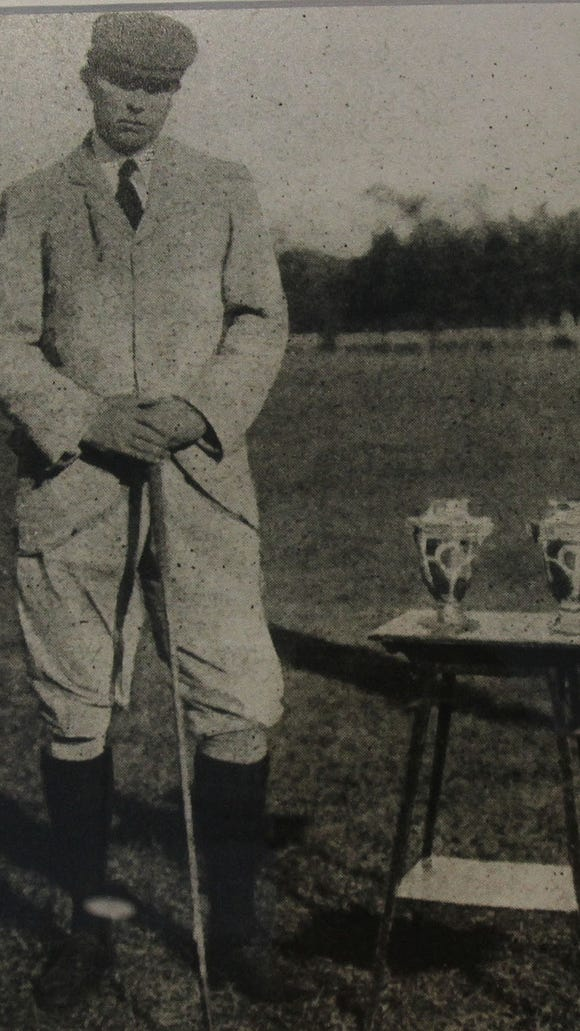 From left, Photo of Charles Sands on display at St. Andrew's Golf Club in Hastings Aug. 5, 2016. Sands was a member of St. Andrew's  and won the first Olympic medal in golf in Paris in 1900.