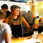 Bartenders Jenn Gibson (top photo) and Nick Westby (lower right) help customers at the Union Barrelhouse, while Jules Miller and Caris Markos (lower left) enjoy time at Sip Coffee and Beer.