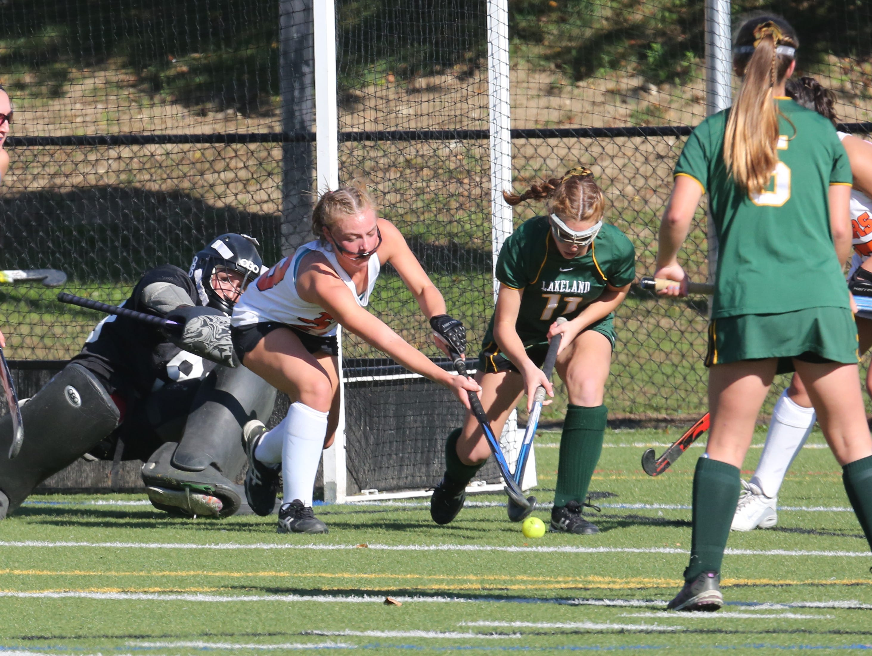 Mamaroneck goalie Charlotte Mackie protects the goal as teammate Emily Mahland and Lakeland's Juliana Cappello try to control the ball during their game in Mamaroneck, Oct 15, 2016.
