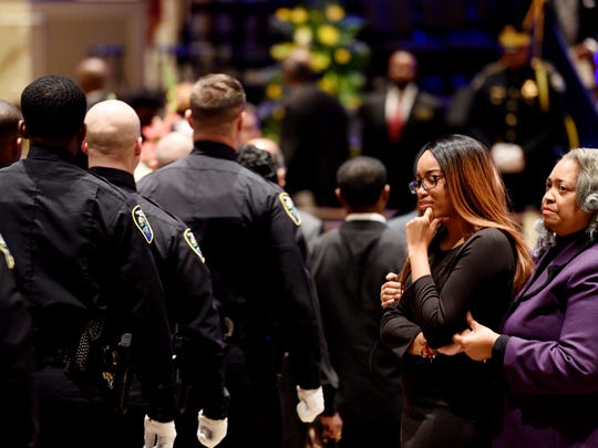 Peyton Comeaux (left), friend of ChatŽri Payne, is comforted by her mother, Jacquie Comeaux, as police officers walk into Summer Grove Baptist Church for the funeral of Shreveport Police Department officer ChatŽri Payne, Saturday January 19, 2019.