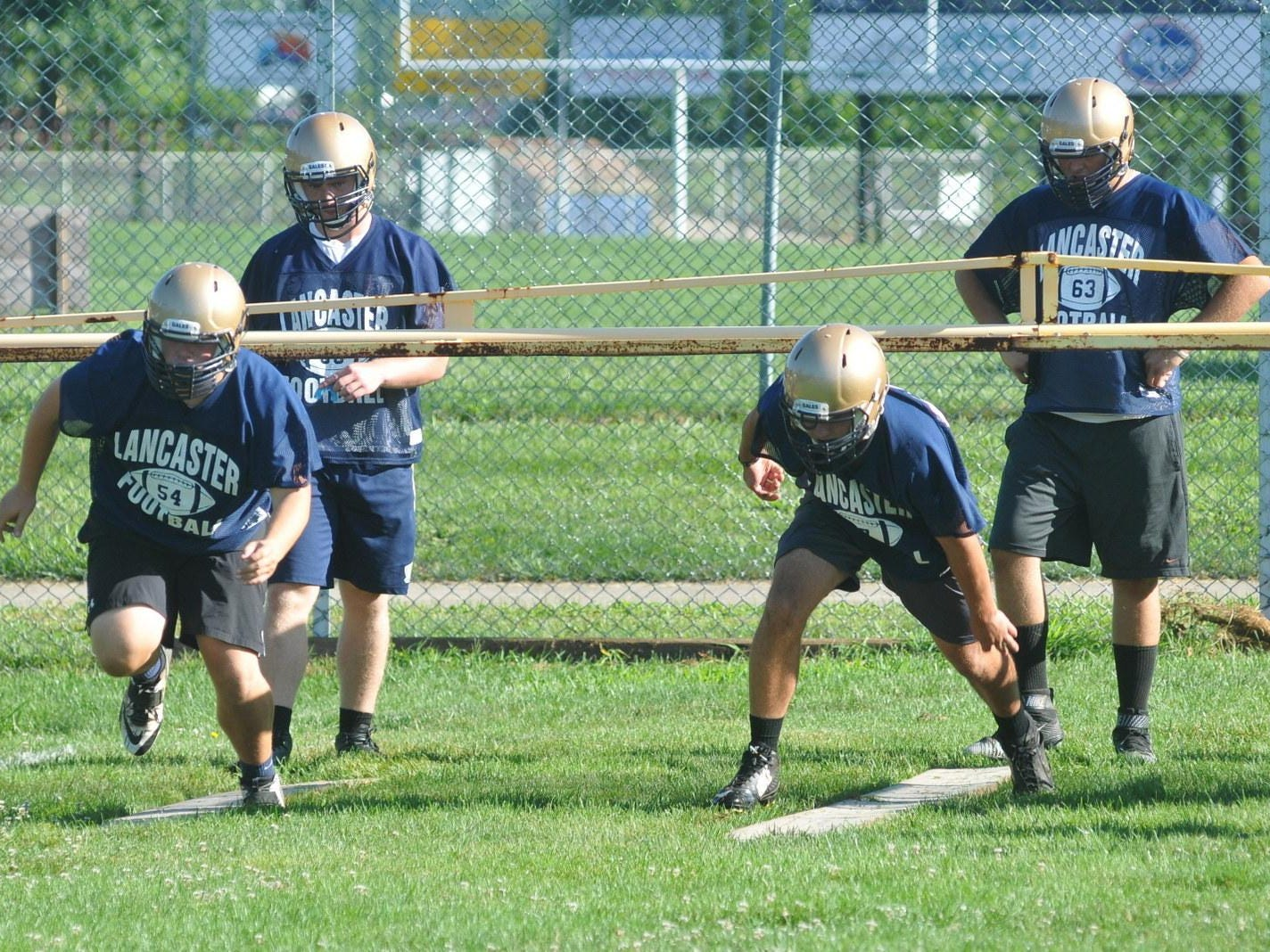 The Lancaster football team officially began practice on Saturday in preparation for the 2015 season.