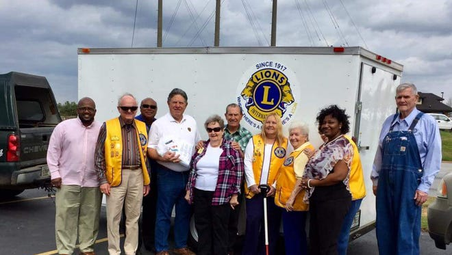 Pictured is one of the trailers and Tallahassee Lions Club members: Rodriguez Gervin, Bruce Bechard, Tallahassee Lions, District O Gov Willie Cooper, Past International President Jim Ervin, Jim and Anne Davis Tallahassee Lions, Debbie McDonald, June Campbell, President Connie Houseman Albany Lions Club, Felicia Simmons, and Roger Houseman.
