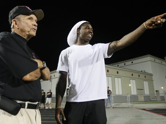KINFAY MOROTI/THE NEWS-PRESS Former South Fort Myers High School player and current Buffalo Bills wide receiver Sammy Watkins, right, attends a game against Lehigh at South Fort Myers. Joe Hampton, a former South Fort Myers High assistant coach, is at left.