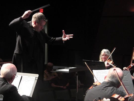 "Artistic director Sean Paul Mills conducts the Salem Philharmonia Orchestra. The orchestra's upcoming concert titled ""Music That Ignites Your Spirit"" on April 22-23 is a low-pressure chance to try something different, Mills said."