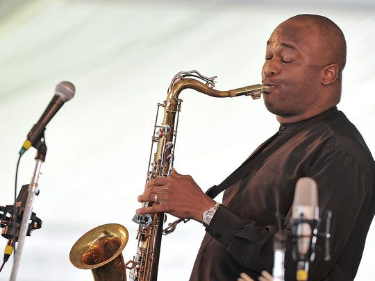 Saxophonist James Carter plays the late Don Byas's tenor saxophone at the Newport Jazz Festival in Newport, Rhode Island, on August 2, 2015. AFP PHOTO Eva HAMBACHEVA HAMBACH/AFP/Getty Images