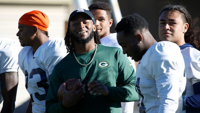 Former UTEP and current Green Bay Packers running back Aaron Jones spent the bye week back home in El Paso visiting family, friends and his former team during practice Wednesday morning. Here Jones walks the sidelines during practice Wednesday morning talking and high-fiving with his former teammates.