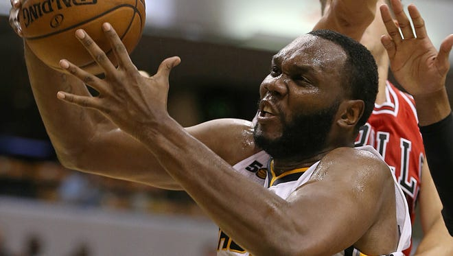 Indiana Pacers center Al Jefferson (7) fights to rebound the ball under the Pacers' basket during first half action against the Chicago Bulls, Banker's Life Fieldhouse, Indianapolis, Thursday, October 6, 2016.