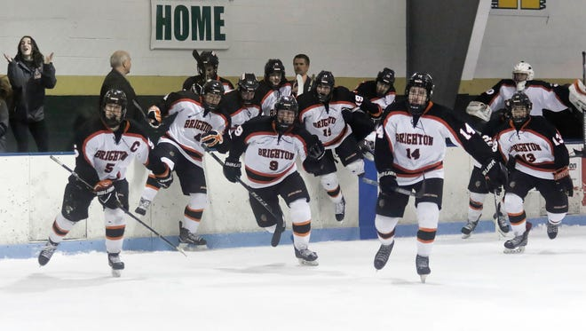 Brighton hockey players flood the ice to celebrate their 3-1 victory over Orchard Lake St. Mary's in the regional championship game on Saturday, March 3, 2018.