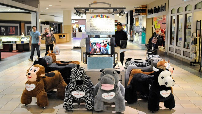 A dozen animal-themed rides are available for rent Friday at the Happy Rides kiosk at Crossroads Center in St. Cloud.