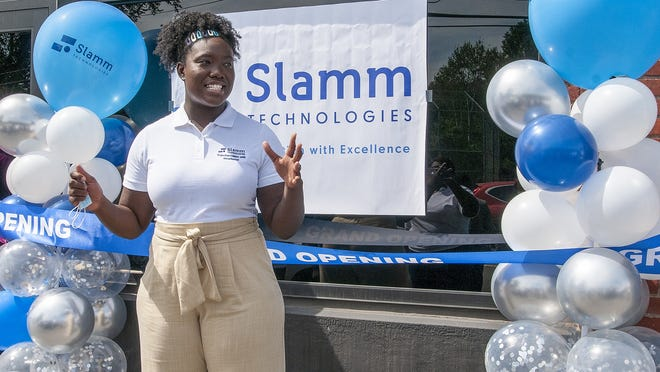 Samantha Boateng, COO, speaks during the grand opening of Slamm Technologies' new IT support and security office on James Street Tuesday.